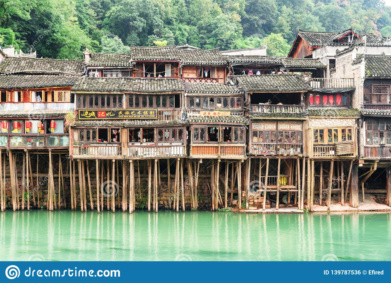 old authentic chinese wooden riverside houses on stilts