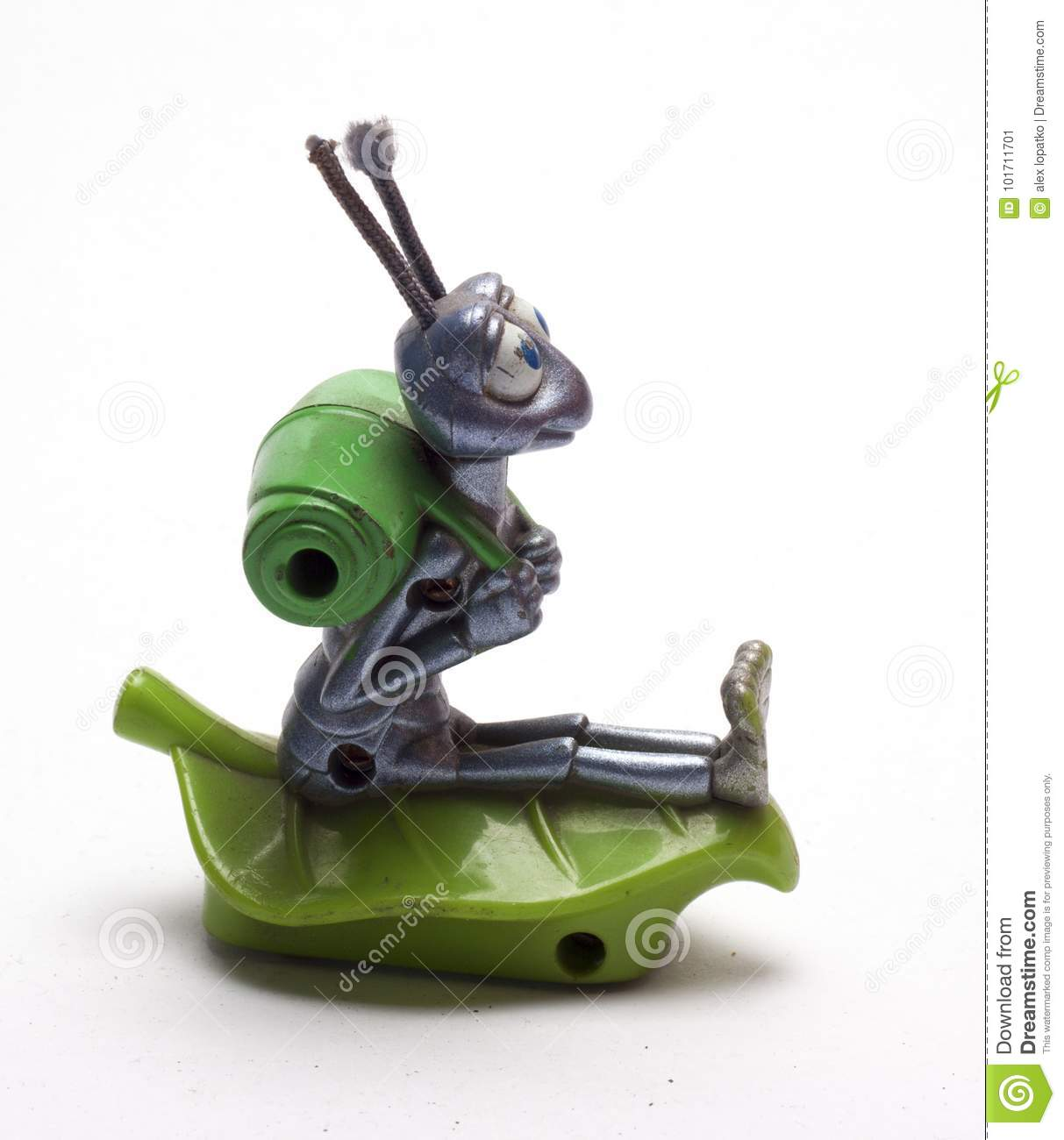 Old baby figurines of animals on a white background/old children`s figurines of animals