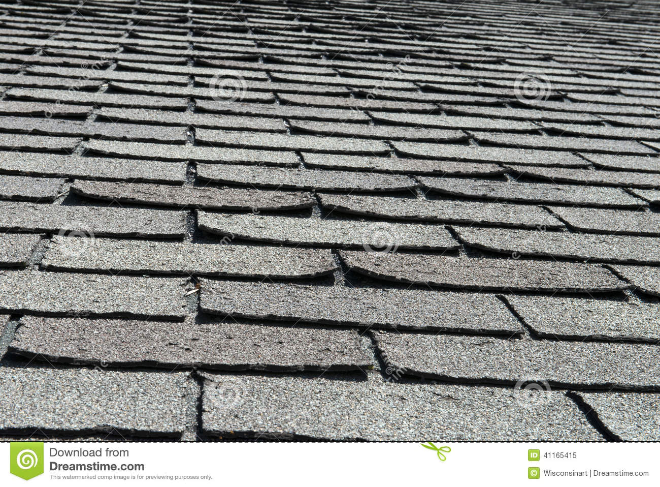 Old Bad And Curling Roof Shingles On A House Or Home Stock