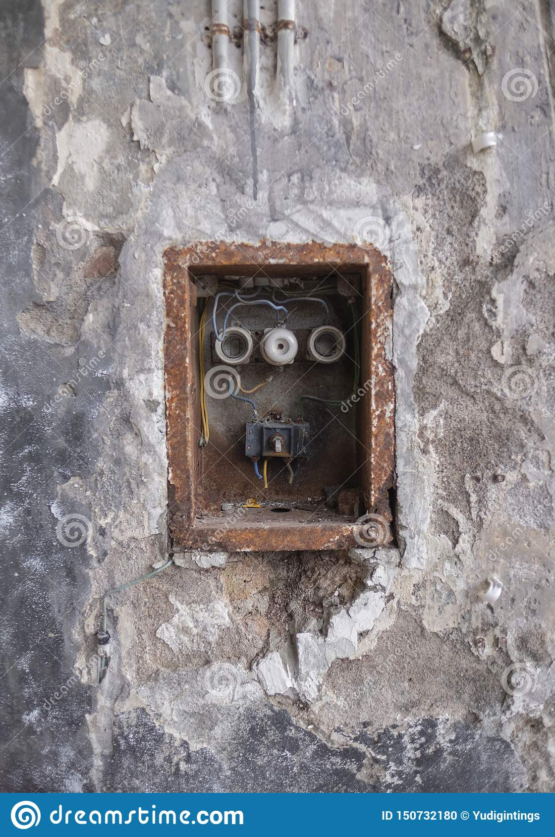 Old Bad Rusty Switch Box on the Weathered Wall