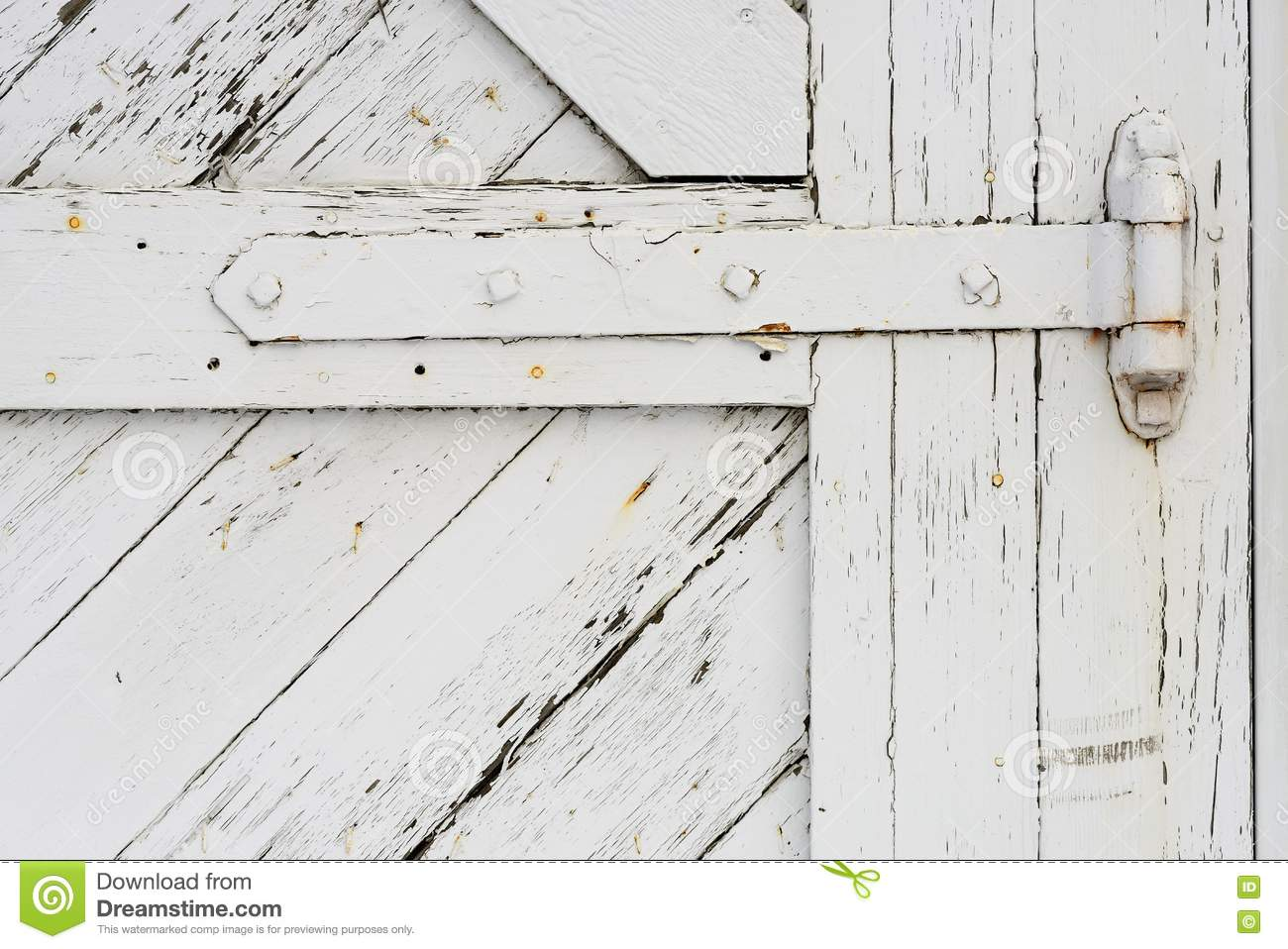A White Painted Hinge To An Old Barn Door.