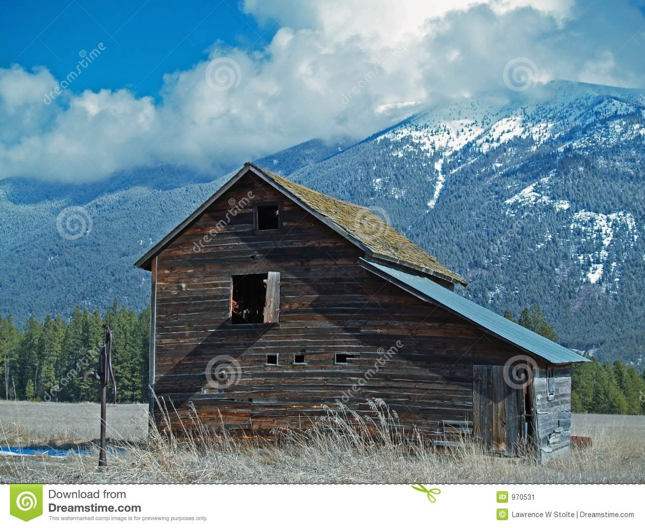 Old Barn Hand Water Pump And Mountains Stock Image