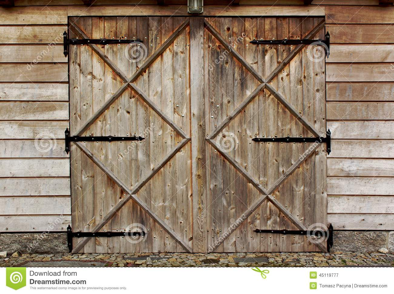 Old barn wooden door with four crosses