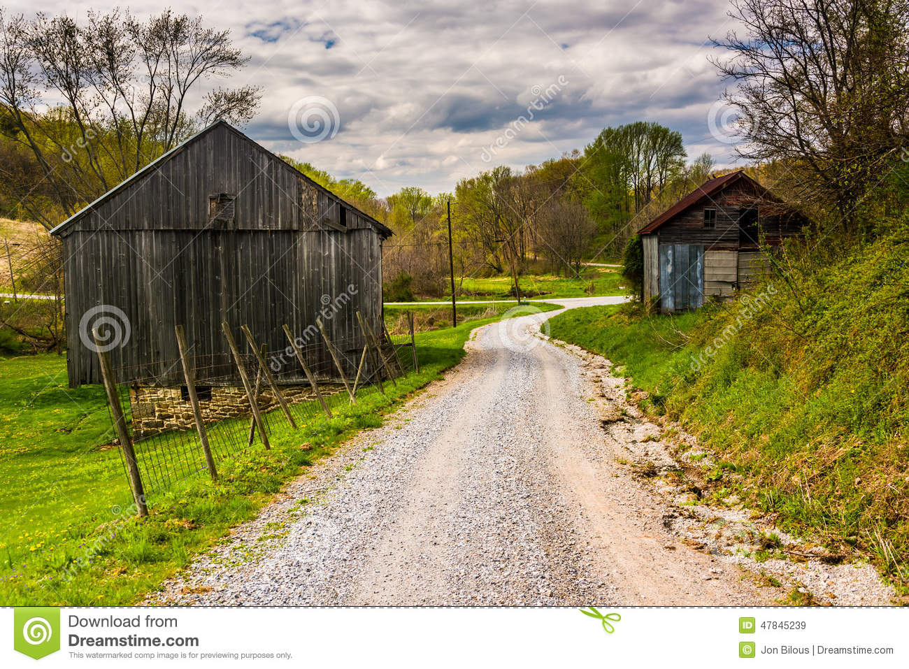 old barns along dirt road rural york county pennsylvania 47845239