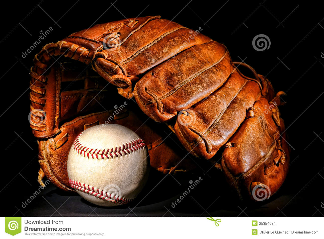 old baseball glove and professional ball on black stock