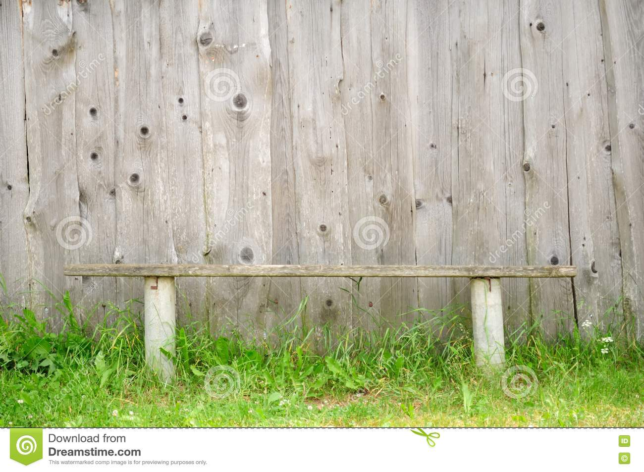 Cool Old Wooden Bench Against Wooden Wall  Stock Photo  Colourbox