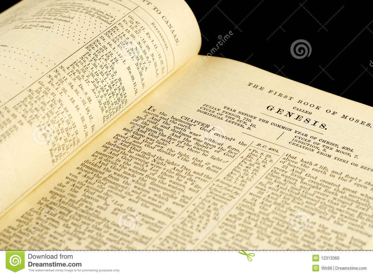 wedding rings on a bible with the genesis text royalty free stock