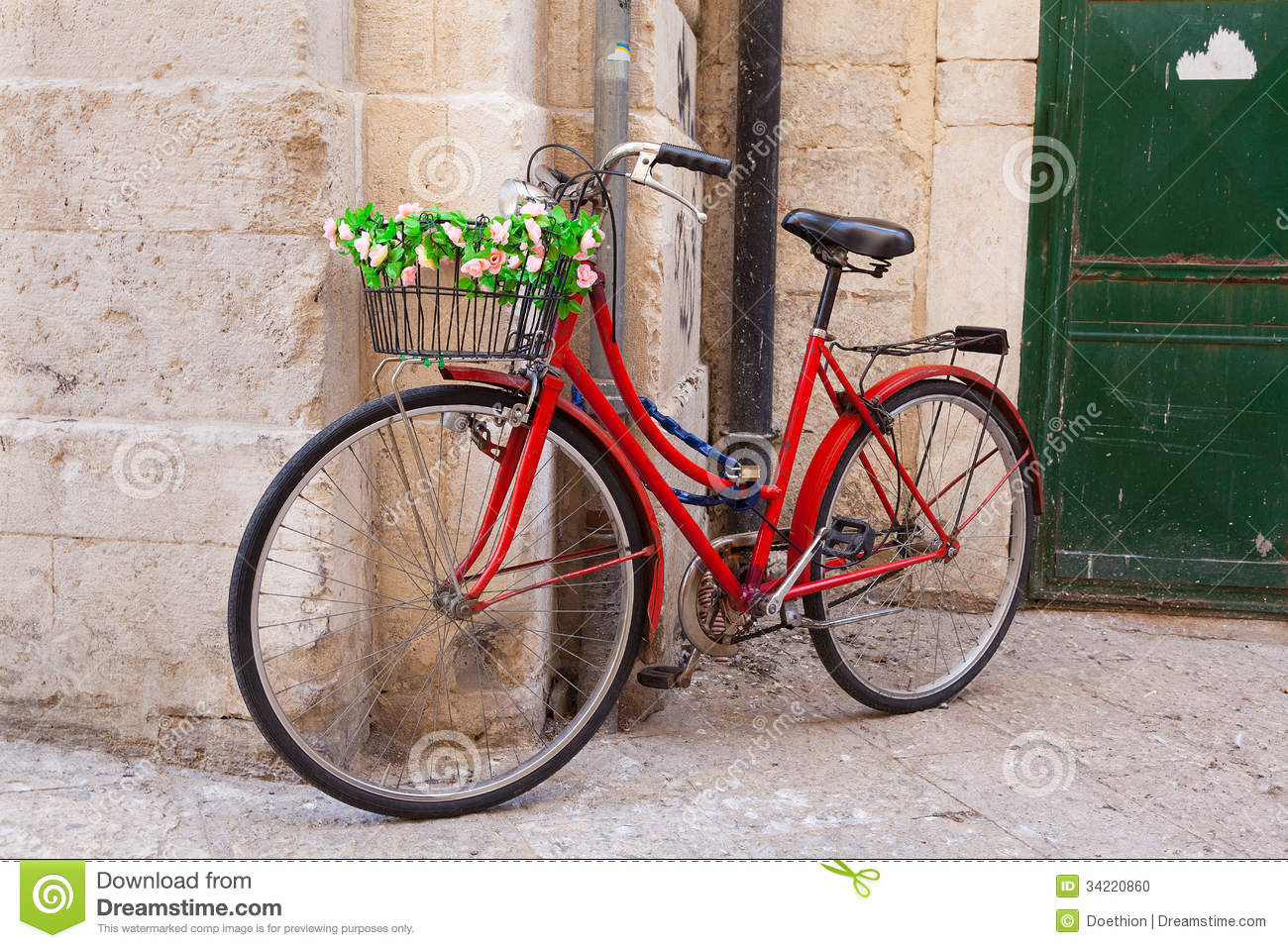 A traditional bicycle with basket leaning against a wall Stock ...