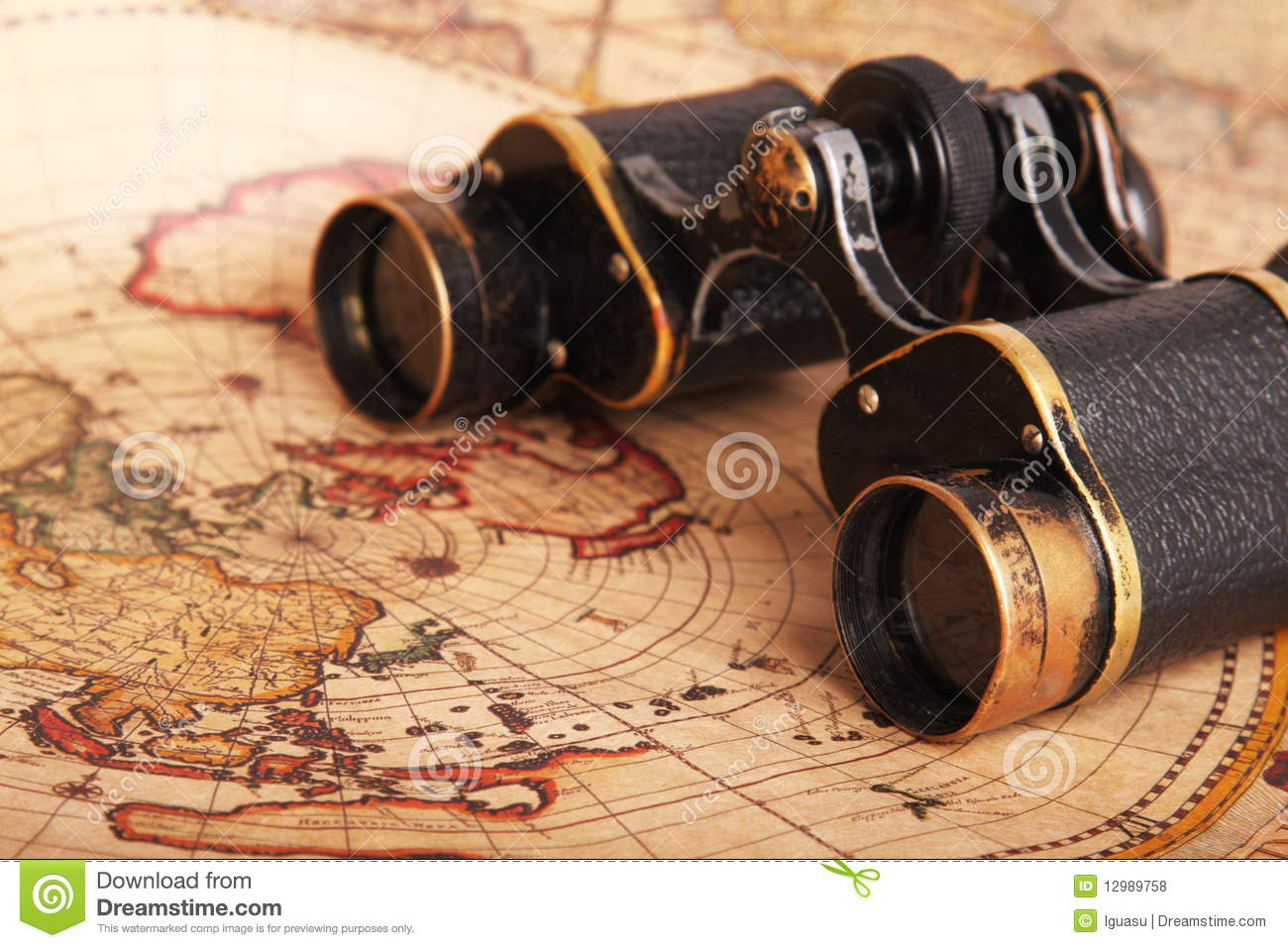 Old binoculars on antique map