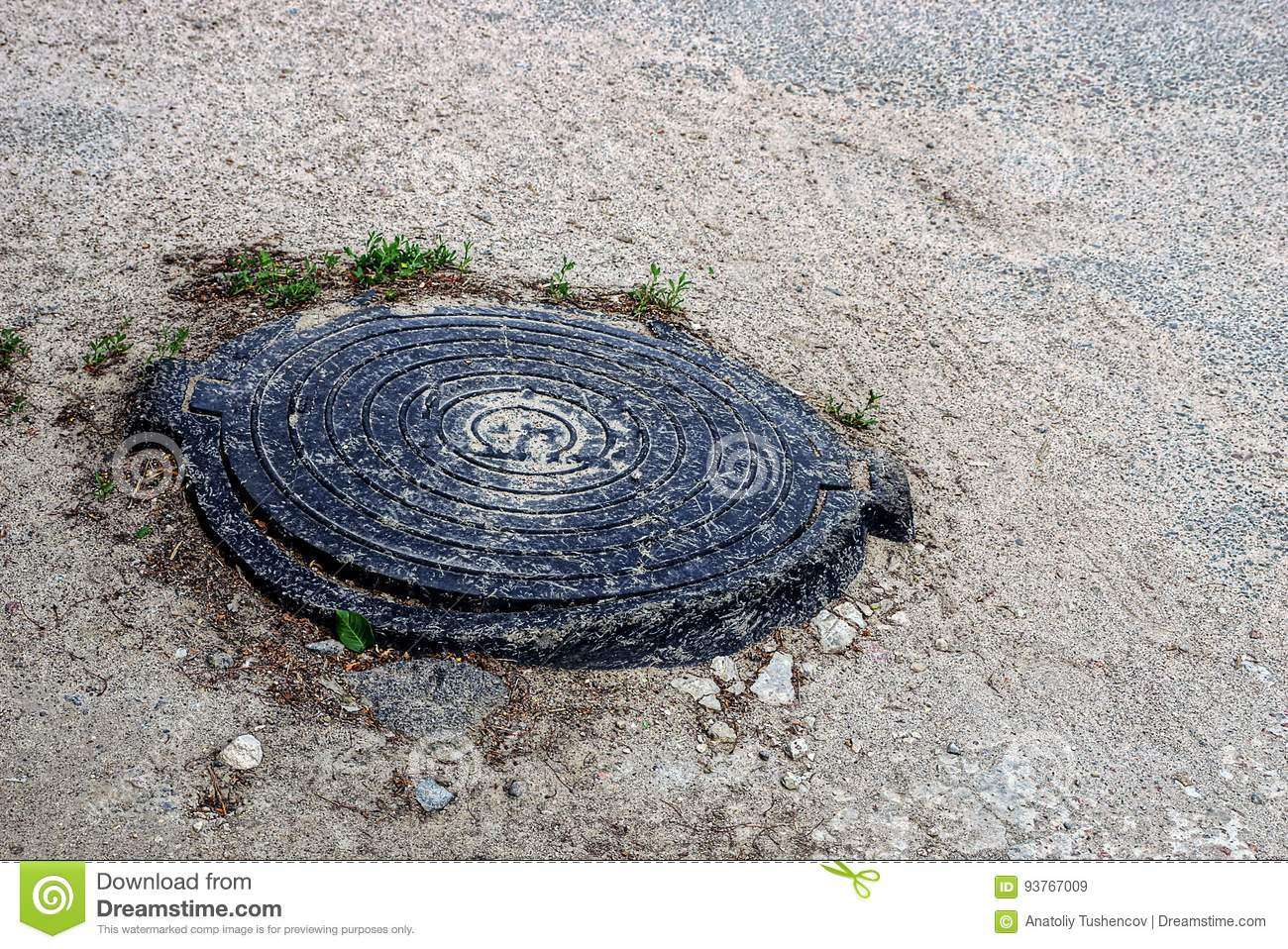 Old Black Cast Iron Hatch On The Asphalt Stock Image Image