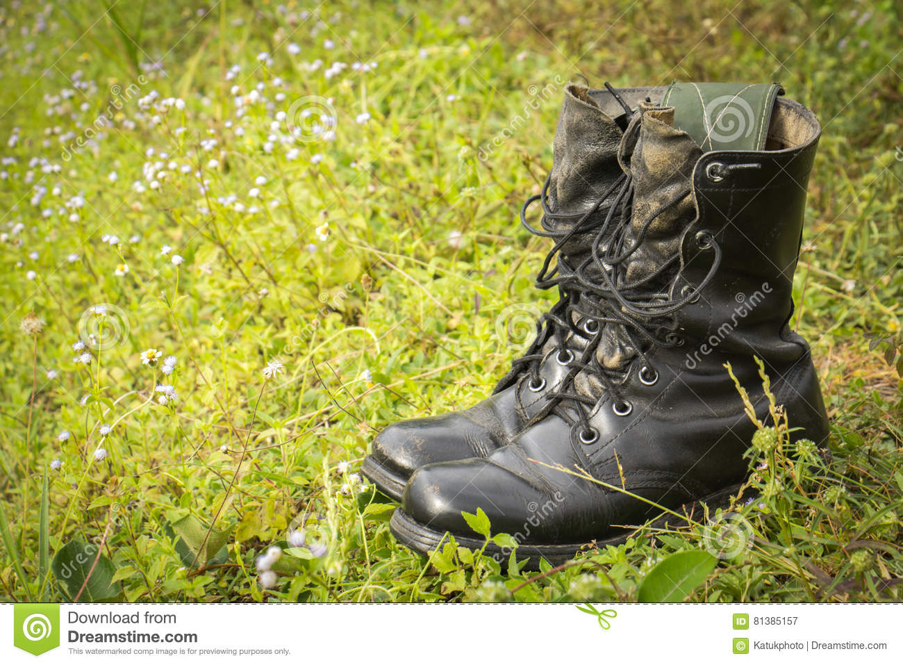 Old black combat boots on grass.selective focus.soft focus the f