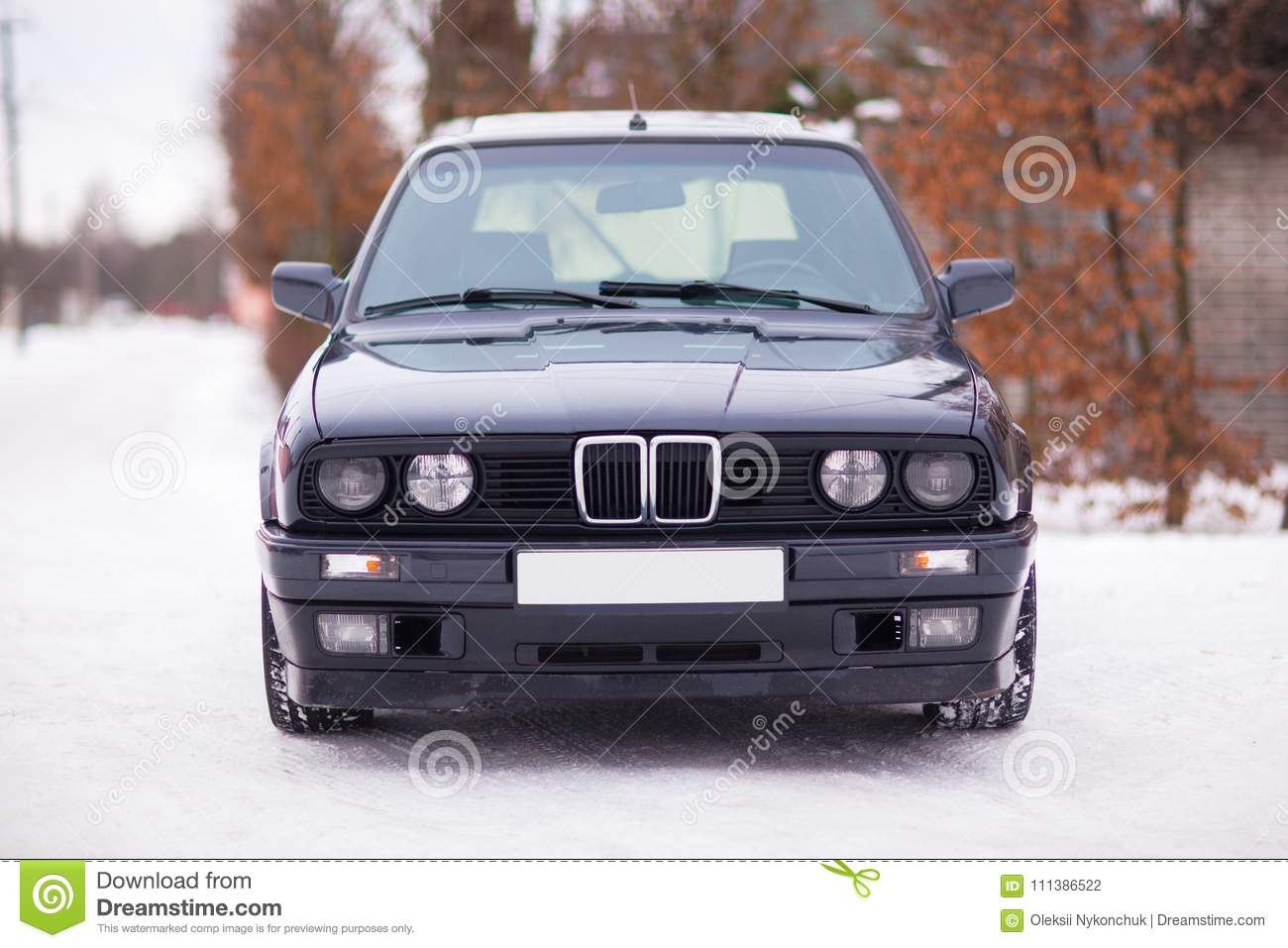 Old Black German Family Car Front View In Winter Stock Photo