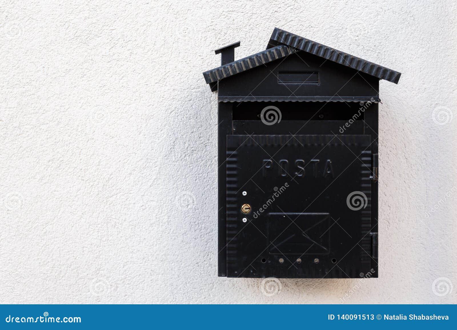 Old black mailbox. Vintage