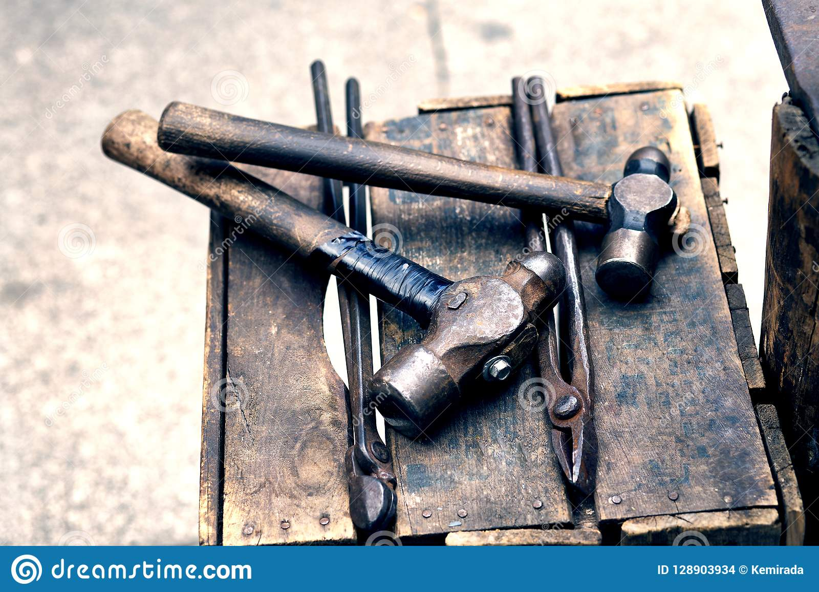 Old blacksmith hammers and tongs to work the steel