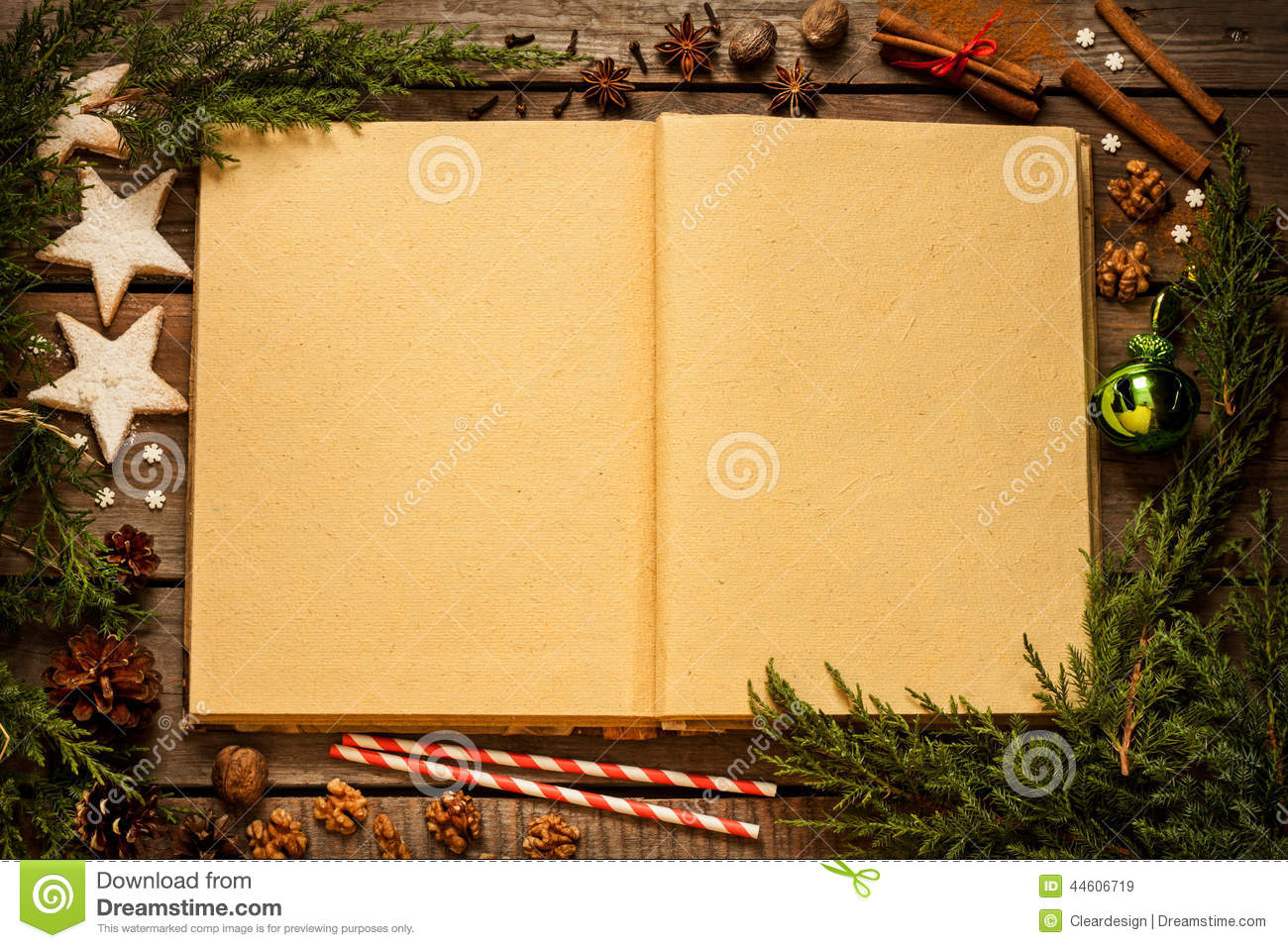 Old blank opened book with christmas decorations around on wood