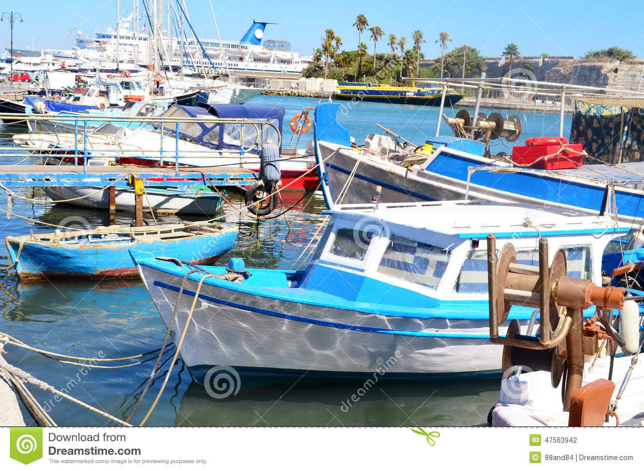 Old blue fishing boat in a sea port stock photo image for Port a fishing