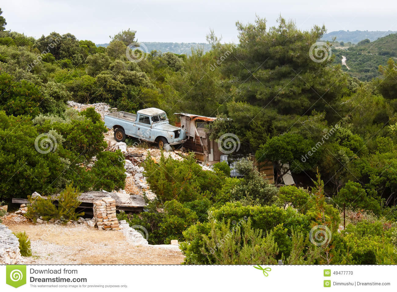 Old Blue Land Rover Pickup Standing Near Small House In