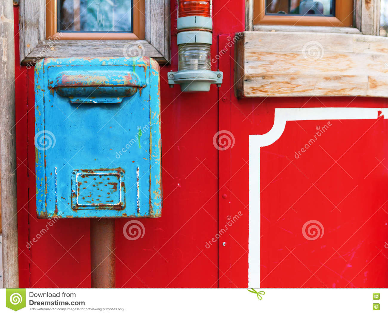 Old Blue Mailbox Hanging On Red Wall