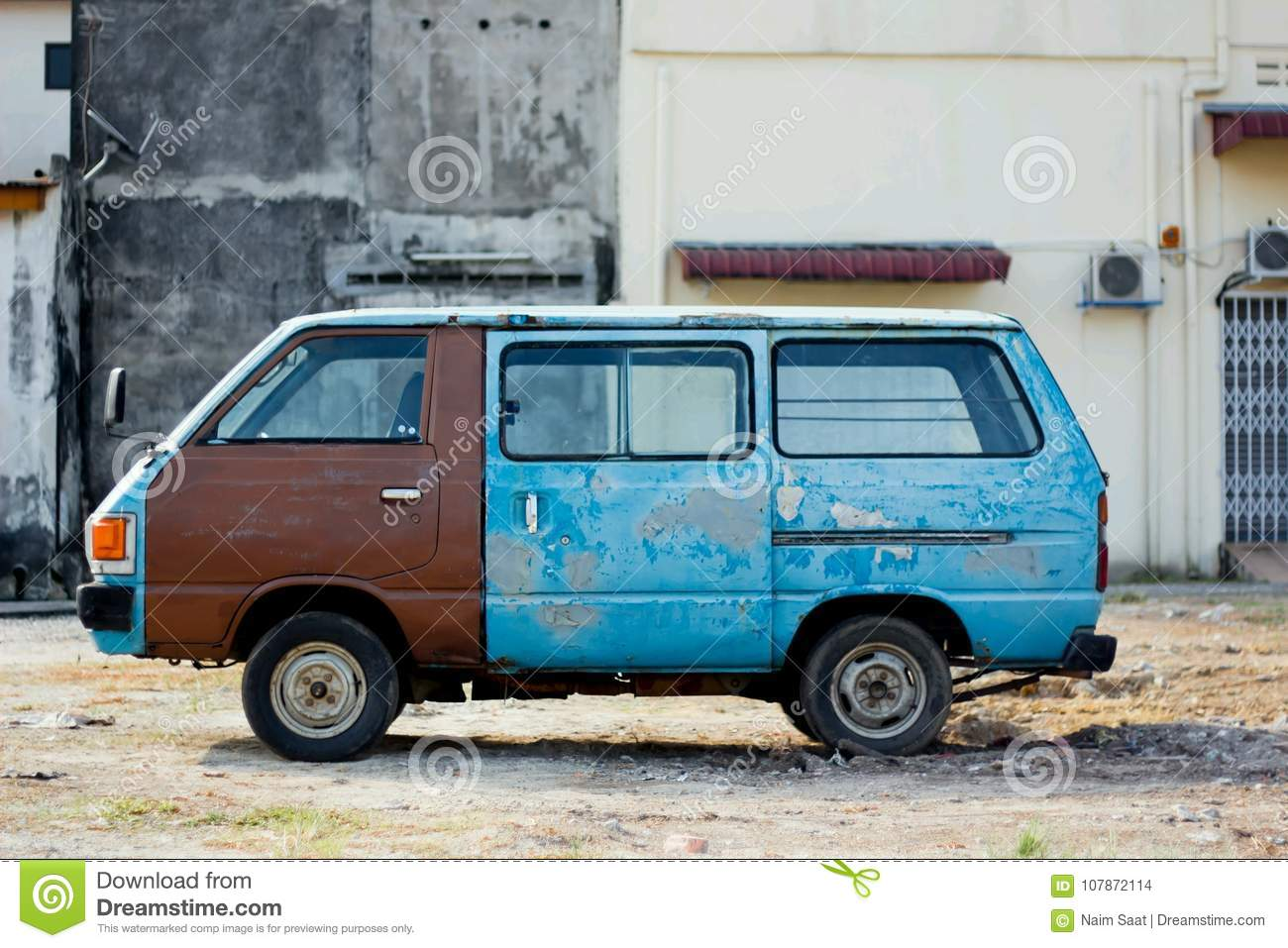 Old Blue Van At Old Building Stock