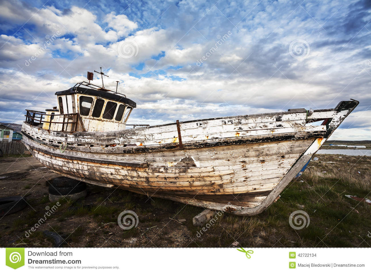 Old boat on junk yard stock photo image of desert for Outboard motor salvage yard