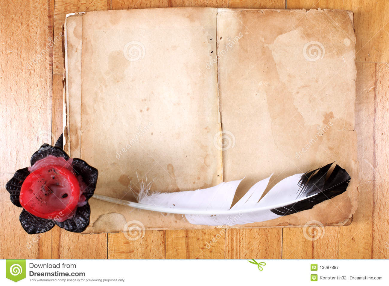 old book with feather pen and candle stock image