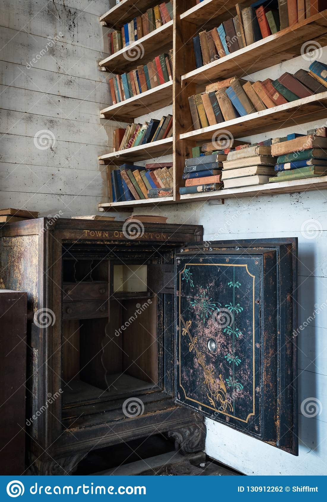 Old Books And A Steel Safe In An Abandoned Schoolhouse Bookshelf
