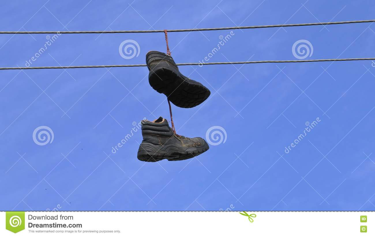 Old Boots Hanging On An Electric Wire On Blue Sky Stock Video ...