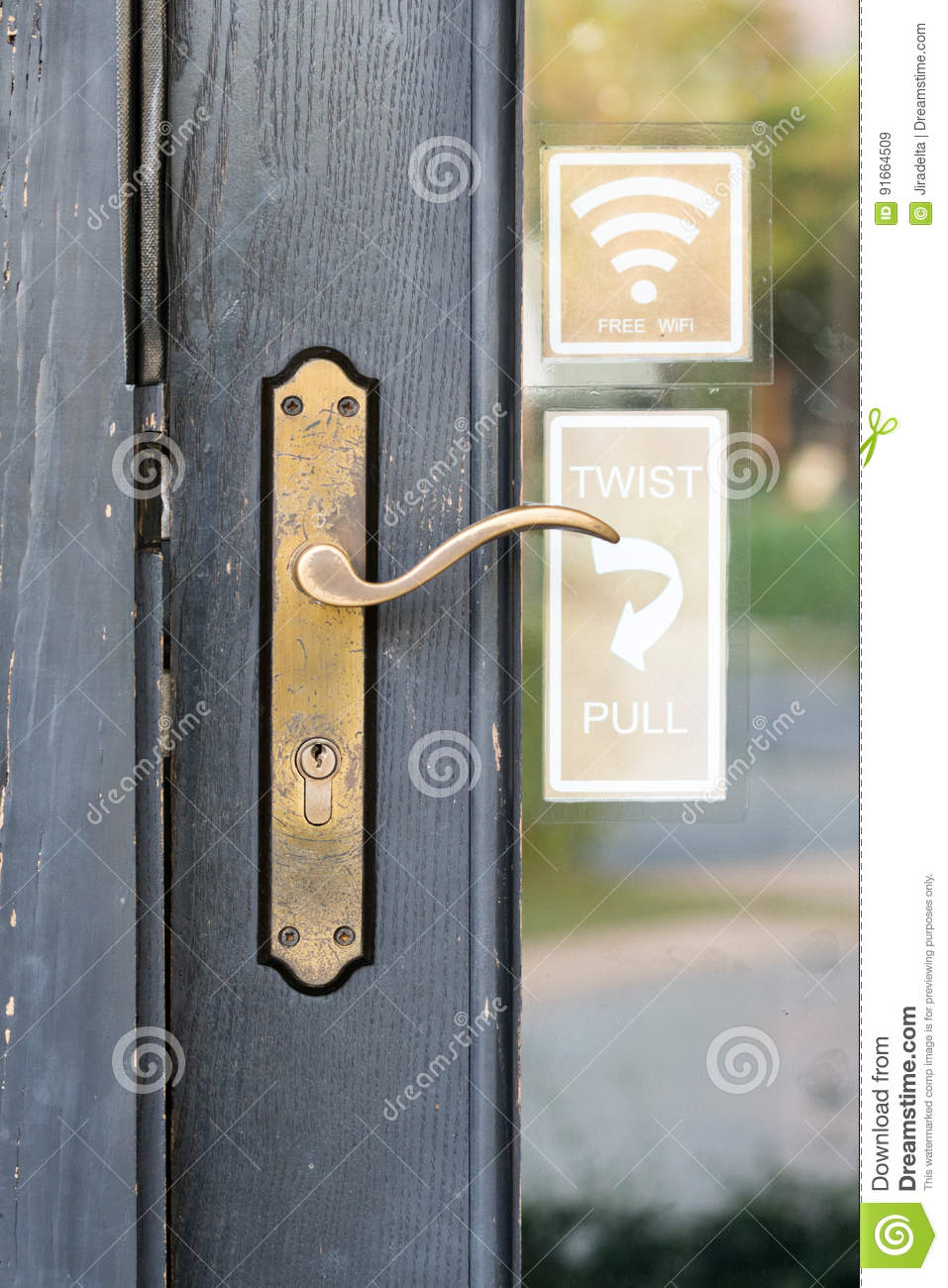 998ae3c403b4 Old Brass Door handles close up with Free Wifi sticker and twist and pull  sticker