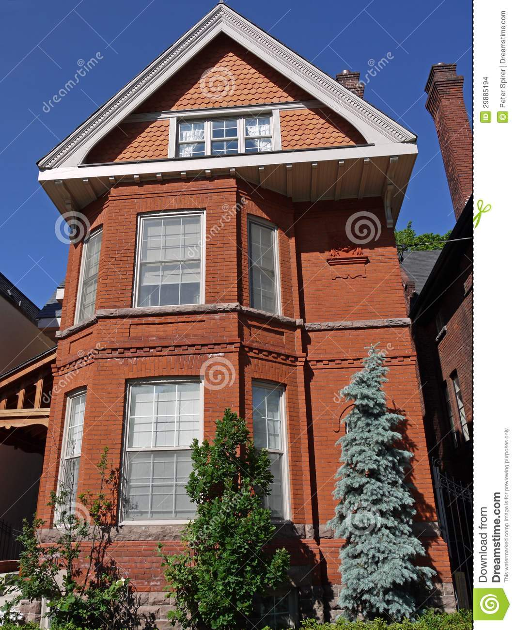 Old Brick House With Large Gable In The Victorian Style