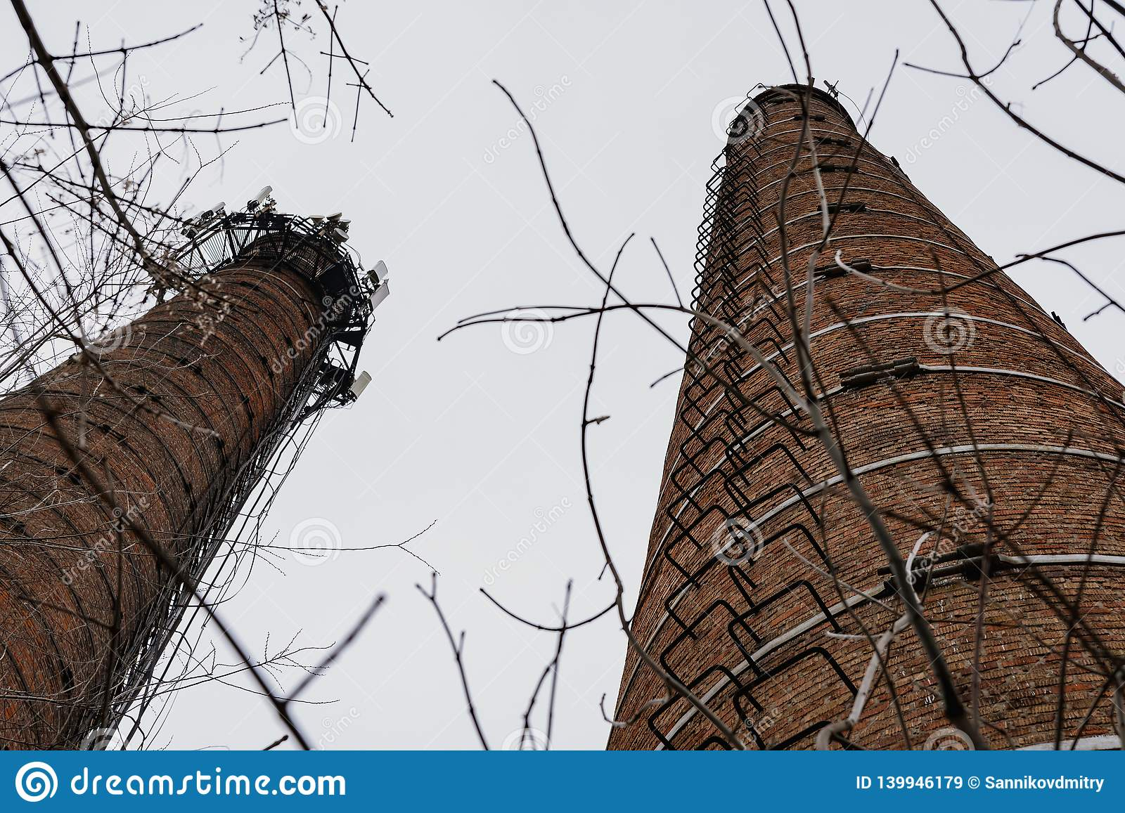 Old brick pipe of the boiler house without smoke.