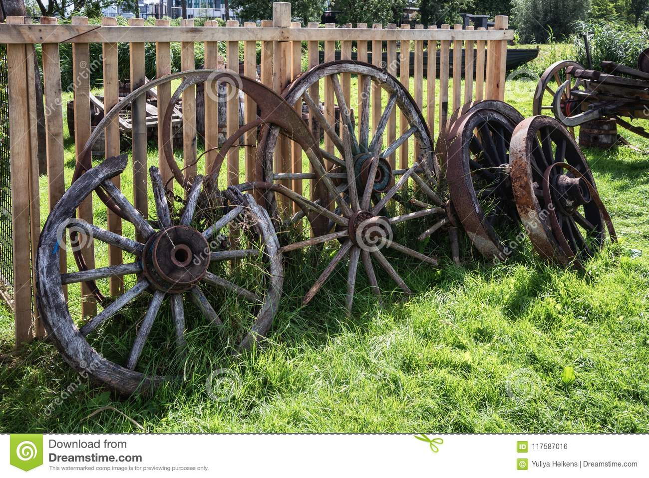 Old And Broken Wagon Wheels Against A Fence Stock Photo Image Of Wagon Broken 117587016