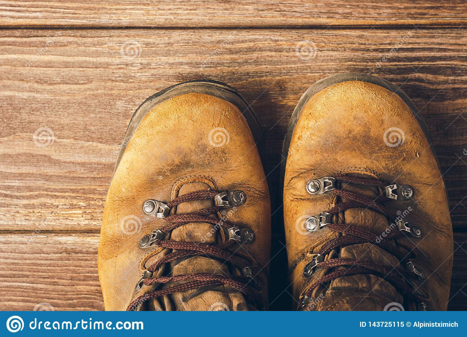 Old Brown Worn Boots Close Up On Wooden Background