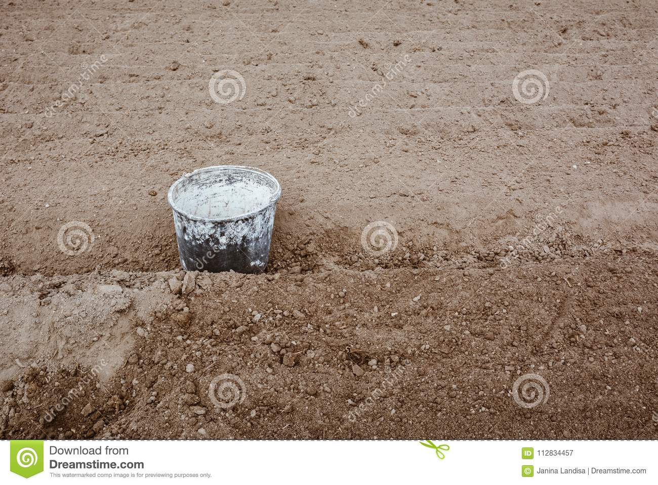 Old Bucket Covered In Paint Lying In The Garden Between Rows Work Concept Copy Space Film Effect Stock Image Image Of Black Future 112834457