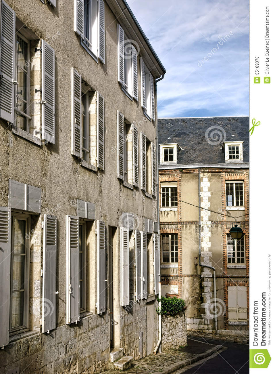 Old buildings and aged house on french town street stock for Traditional house building