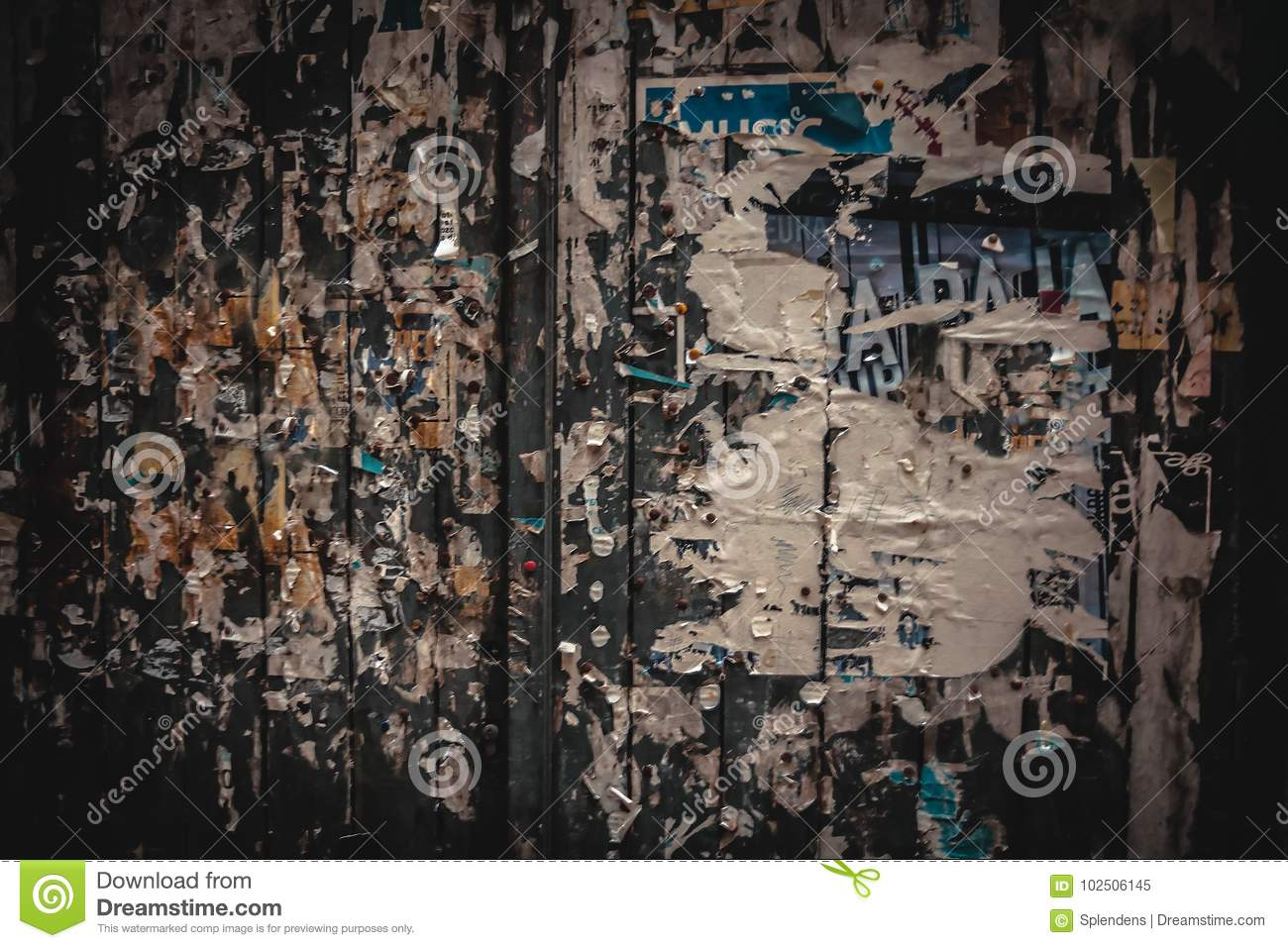 Old bulletin board with torn off paper ads stock image image of old bulletin board with torn off paper ads gumiabroncs Image collections