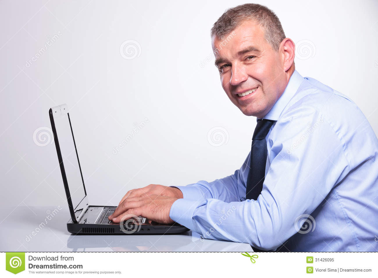 Old business man working on his laptop