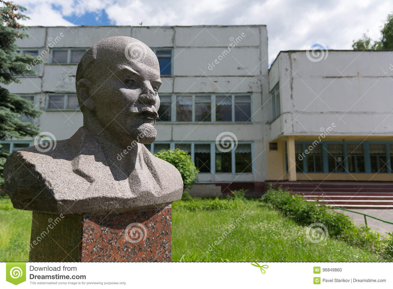 Old bust of Lenin on the background of the old Soviet building