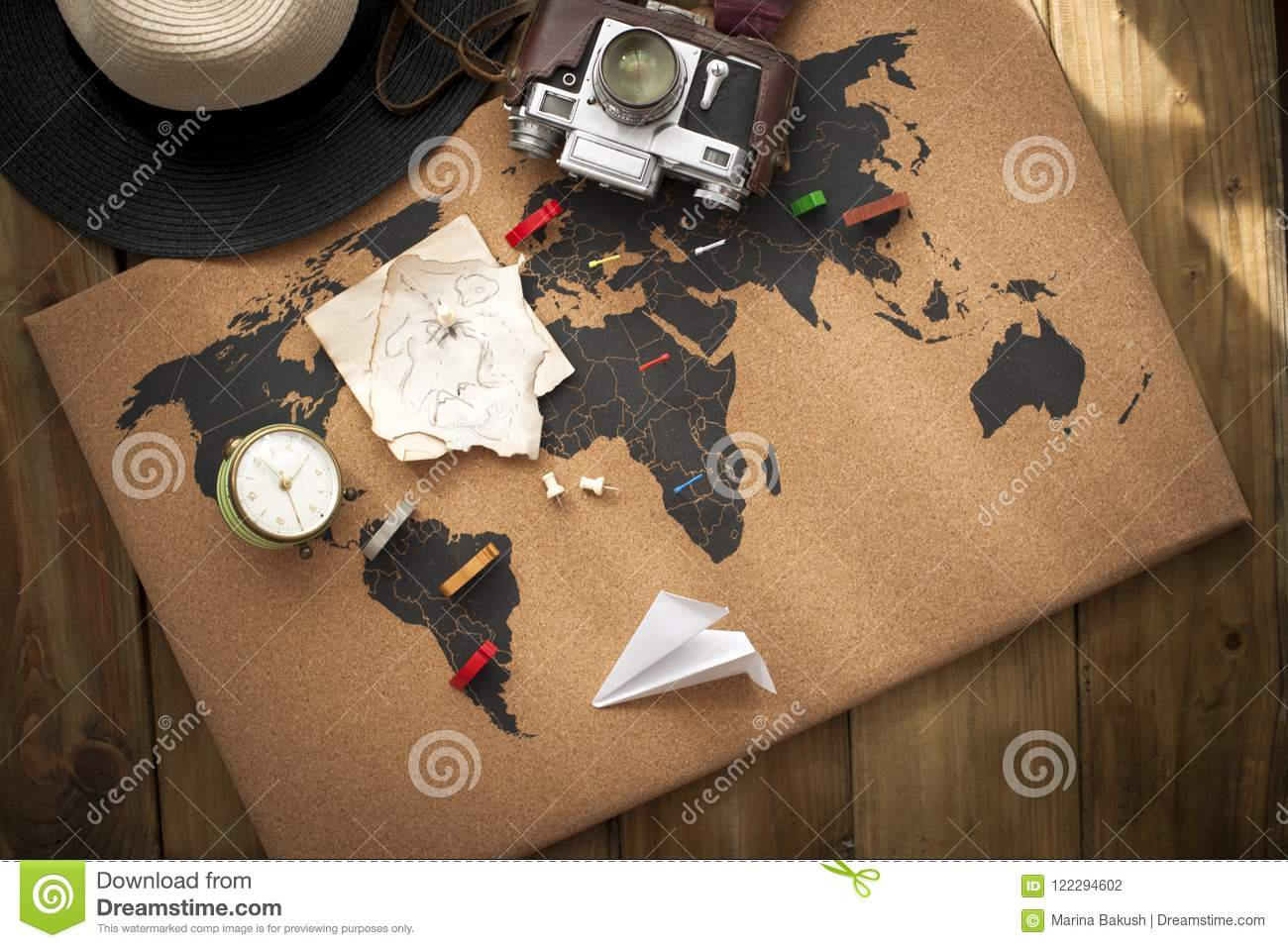 Old camera and route plan on the map, vintage photo. Travel and holidays. Copy space