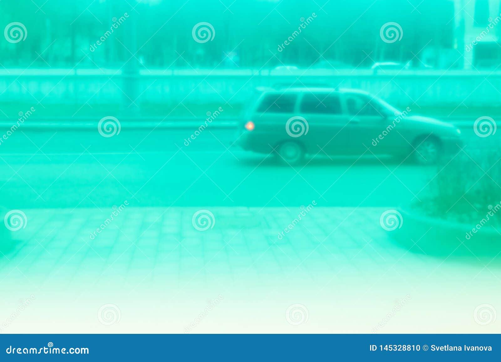 Old car rides around town. View through green glass. Retrowave.