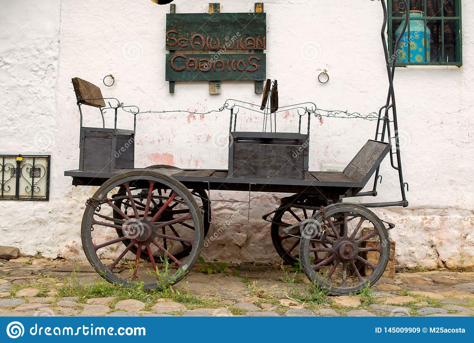 Old carriage parked at an old stone paved street