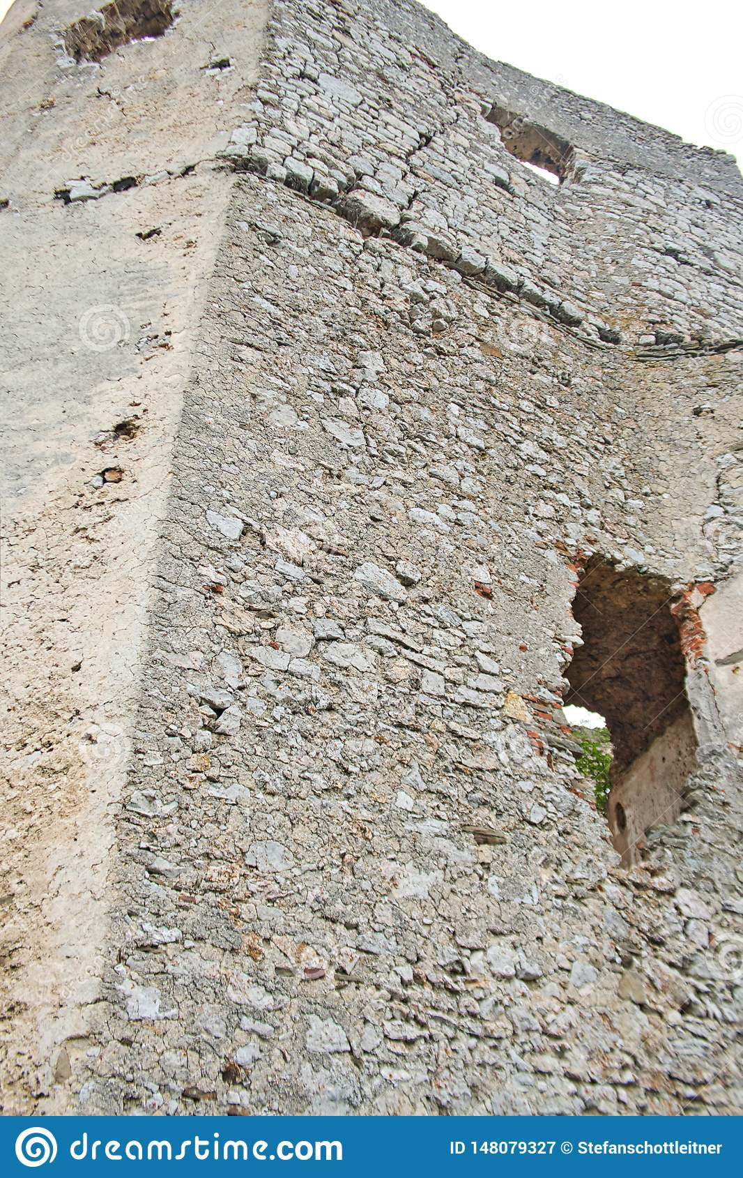 an old castle wall with a hole