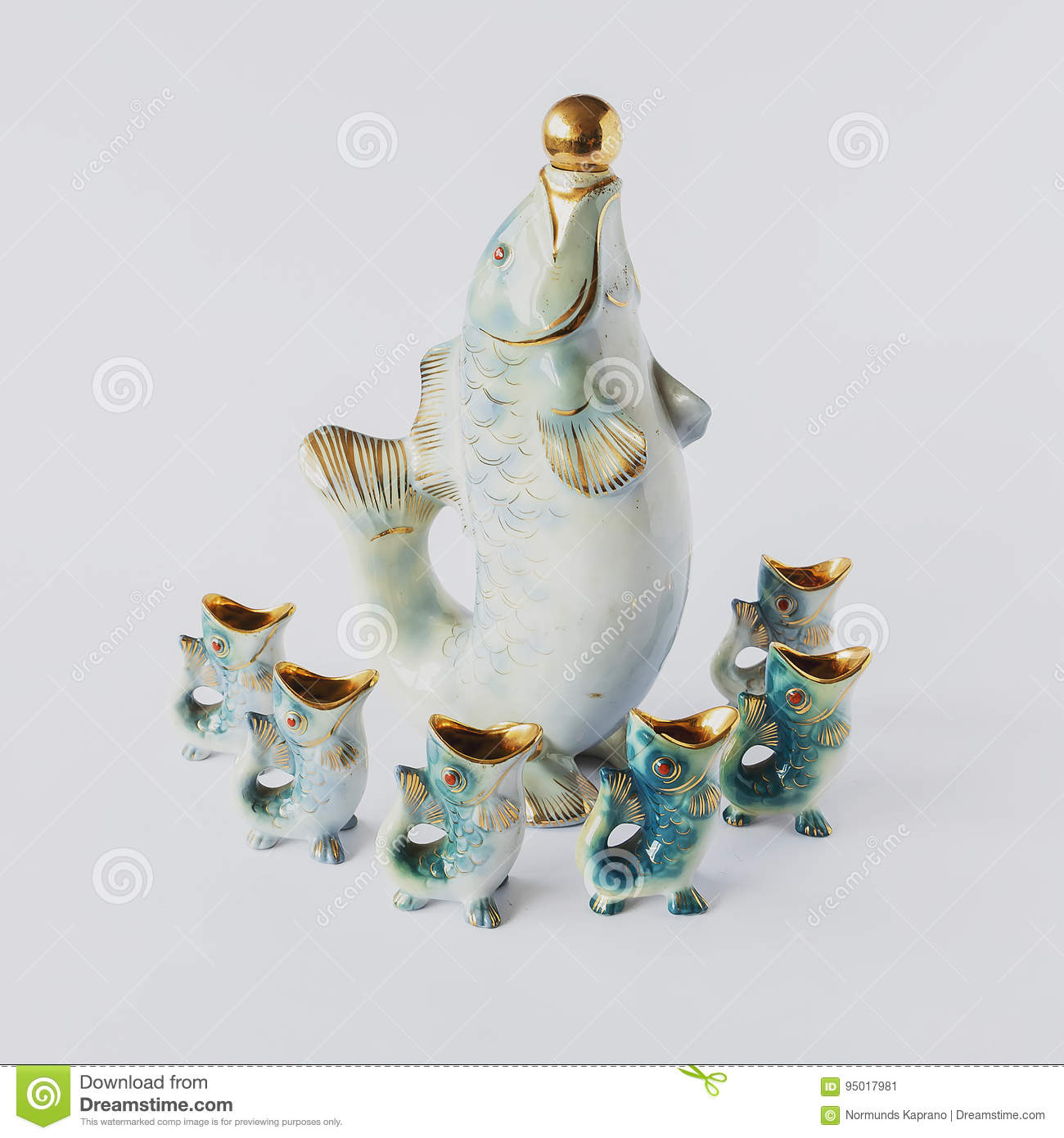 Old ceramic figurines on a white background