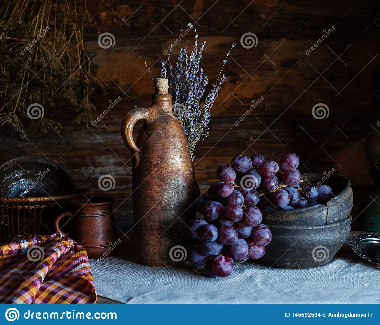 Still life in a rustic style. ceramic dishes and  fruits