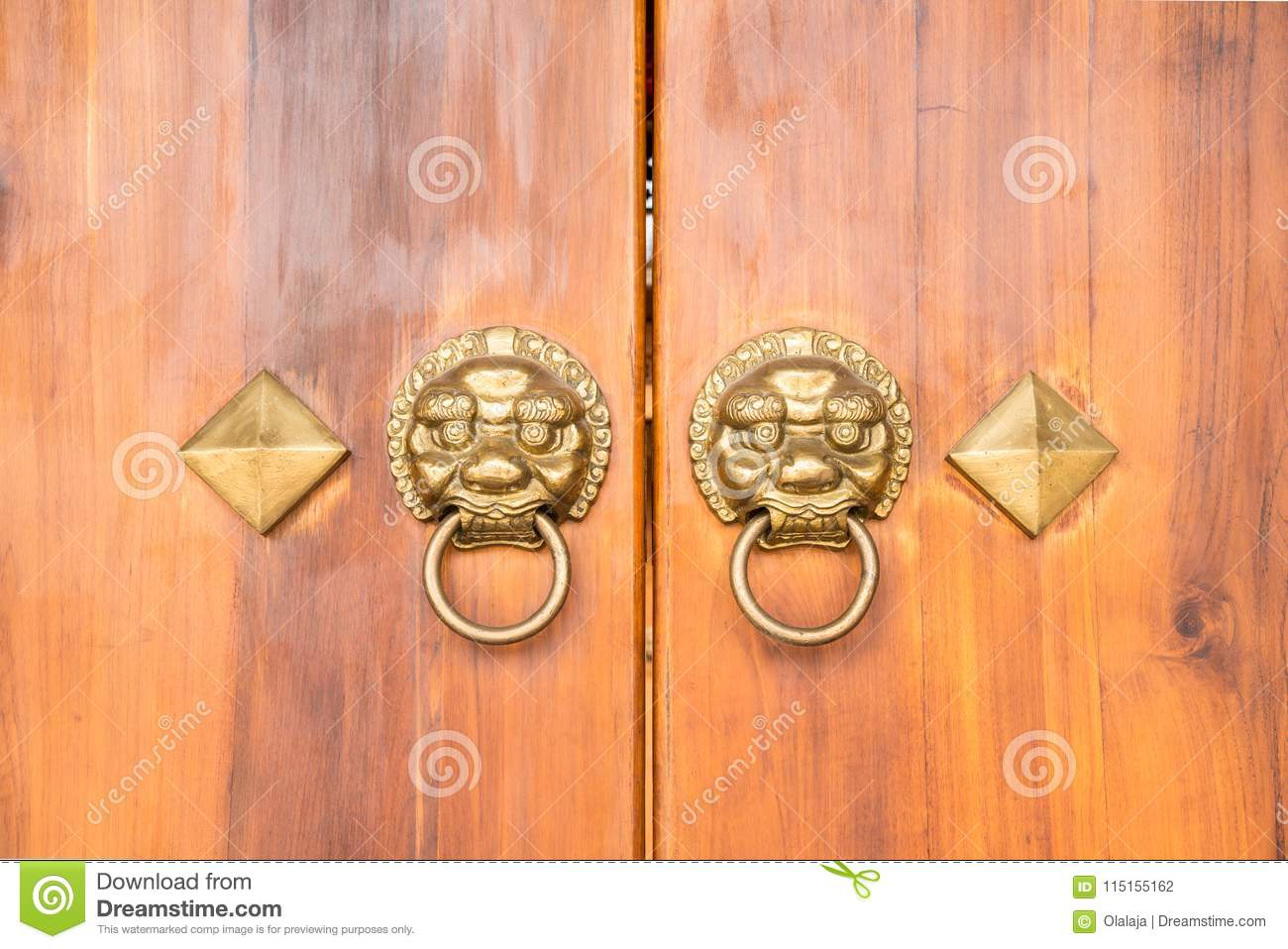 Old Chinese wooden door style with lion head knocker