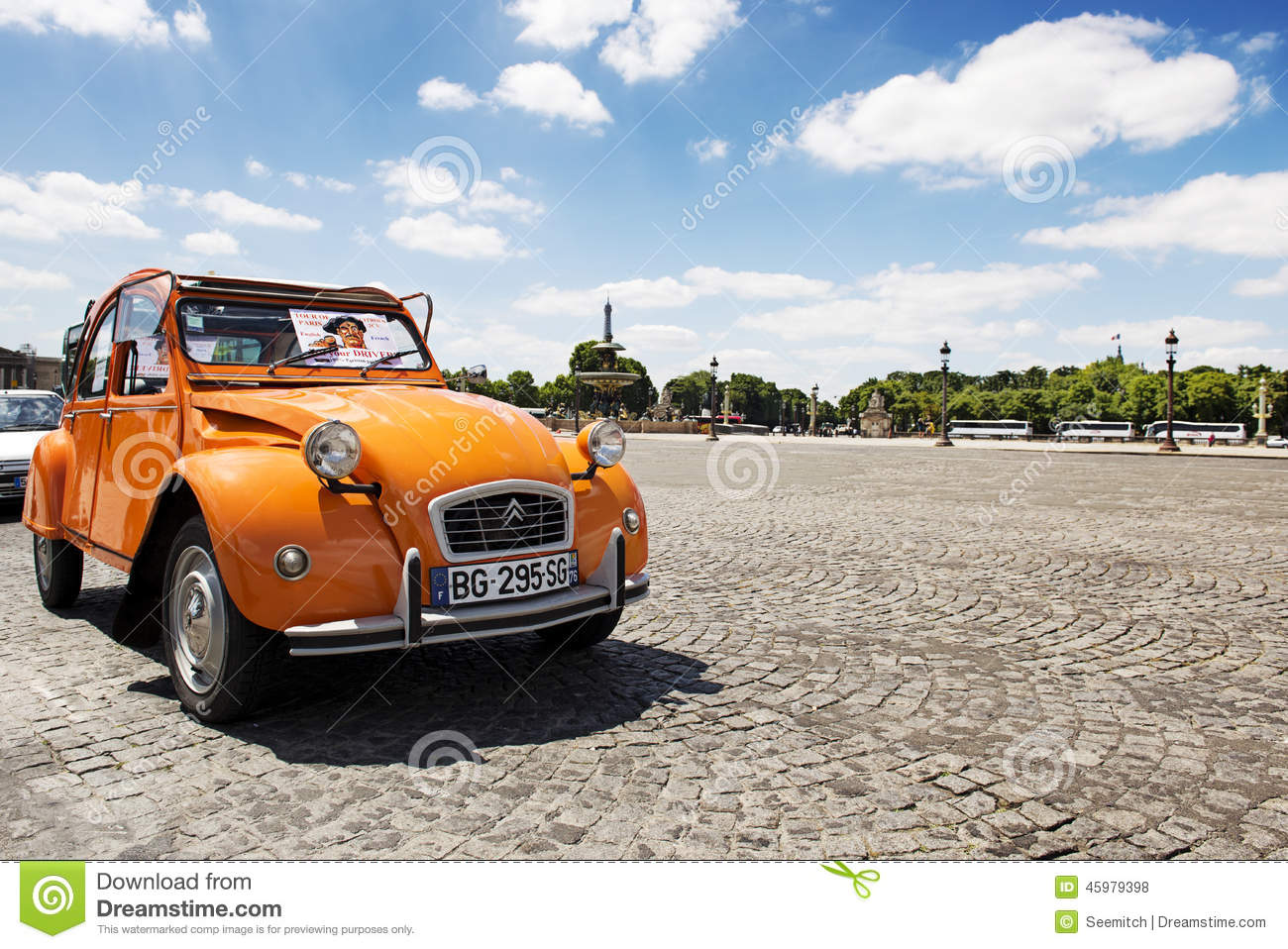 old citroen 2cv parked at place de la concorde editorial