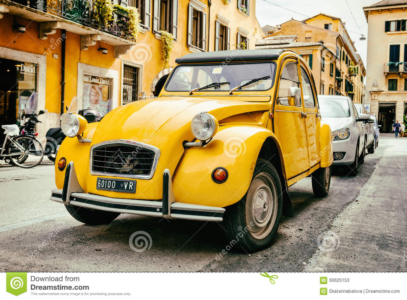 old citroen 2cv parked on the street of verona editorial stock photo