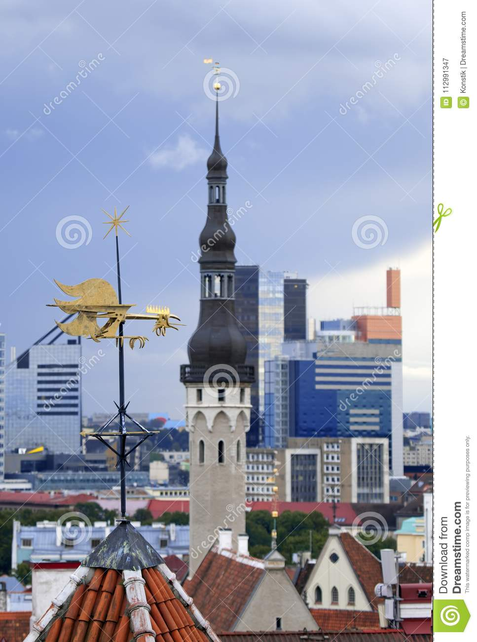Old city, Tallinn, Estonia. A medieval weather vane rooster, bird over the city