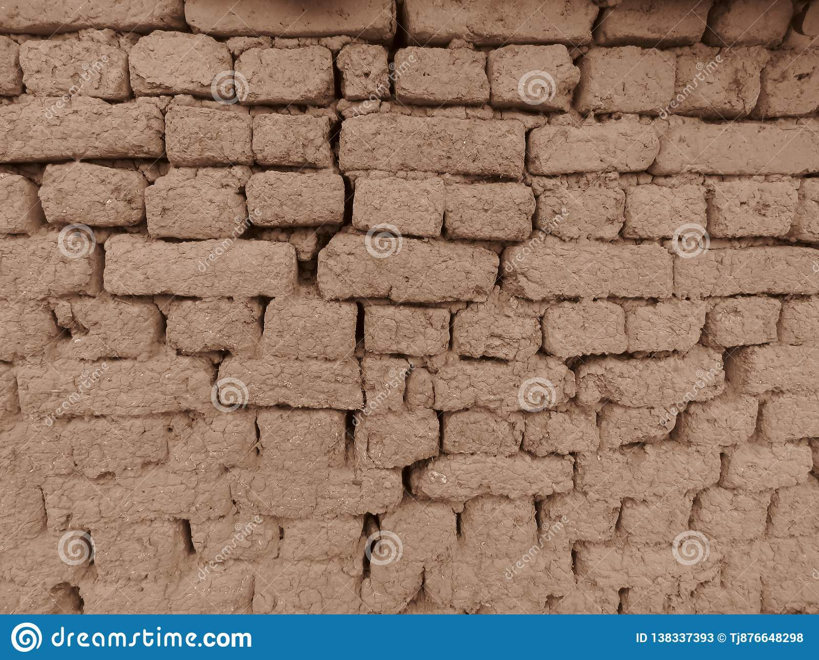 Old clay brickworks in Sepia colour. Wall clay bricks and cracks suitable for rustic retro style background.