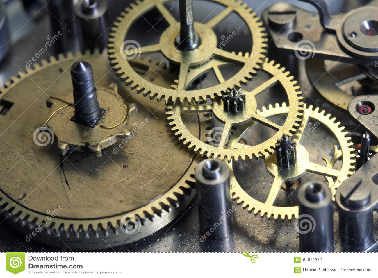 Old Clock Gears : The old clock mechanism with metal gears and screws stock