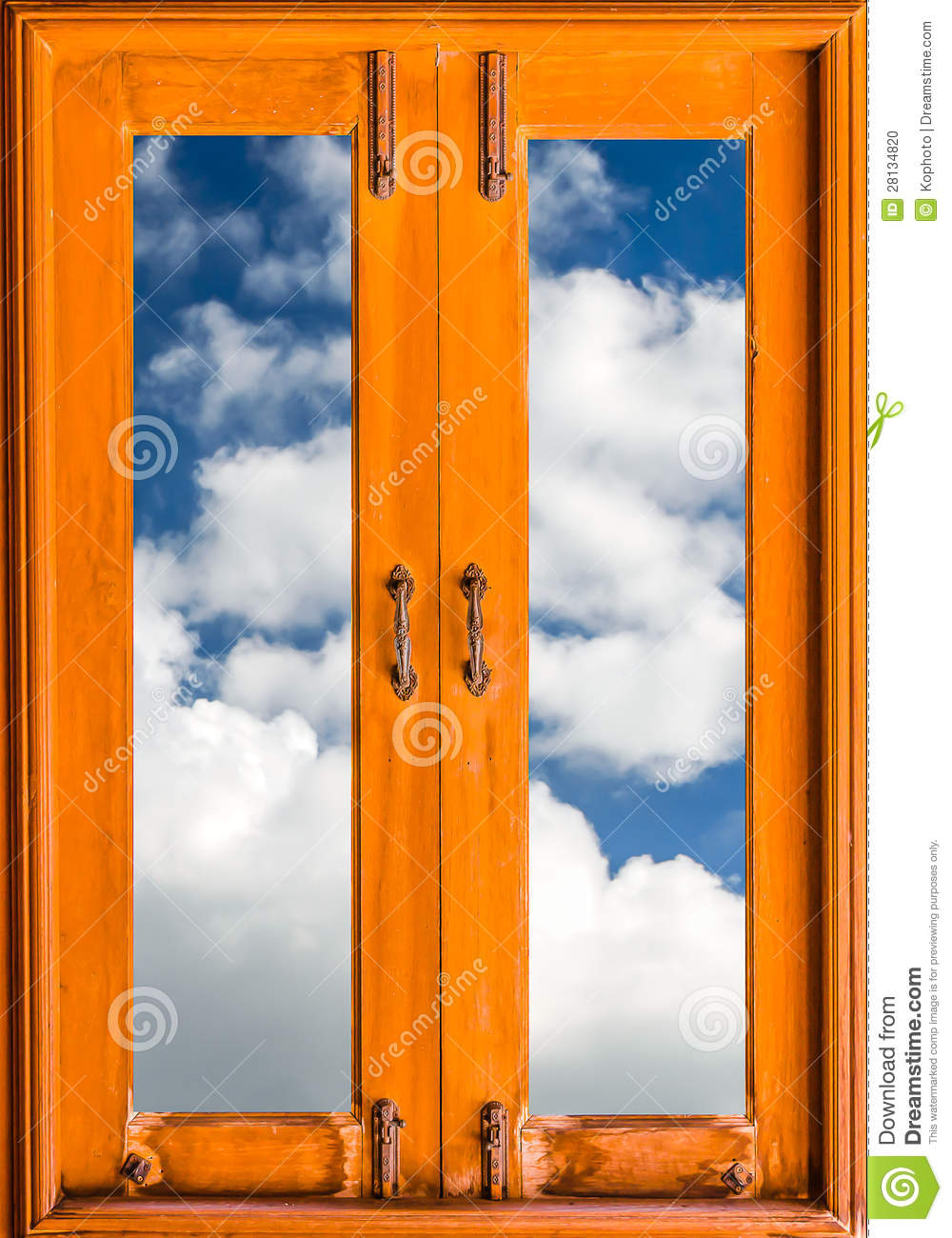 Old closed wood glass window frame with clouds